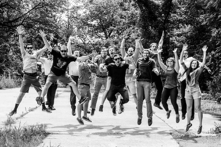 The Designblendz team in 2016 jumping in the air