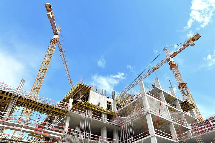 Image of commercial construction site and crane