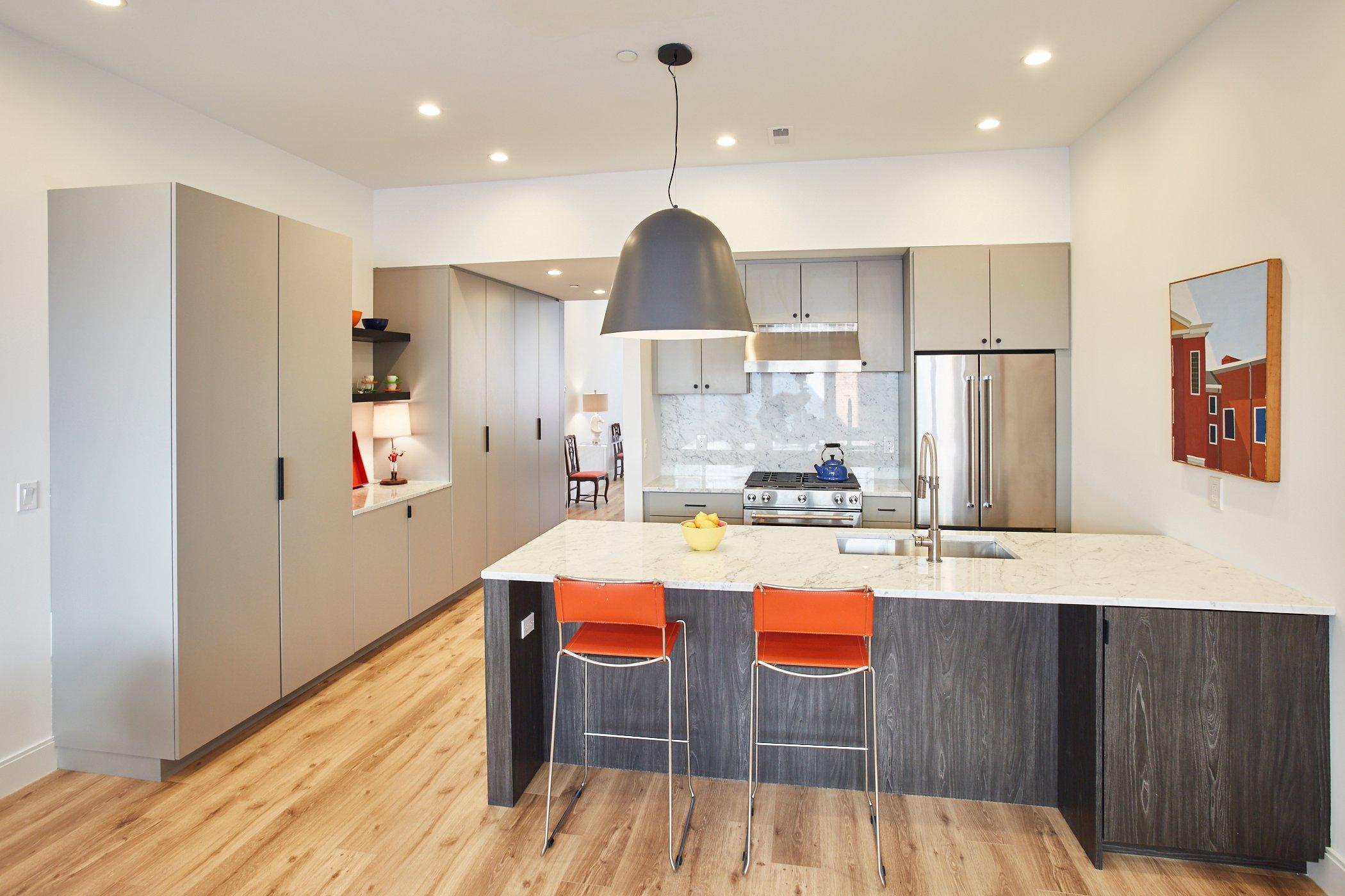 Interior kitchen with orange chairs